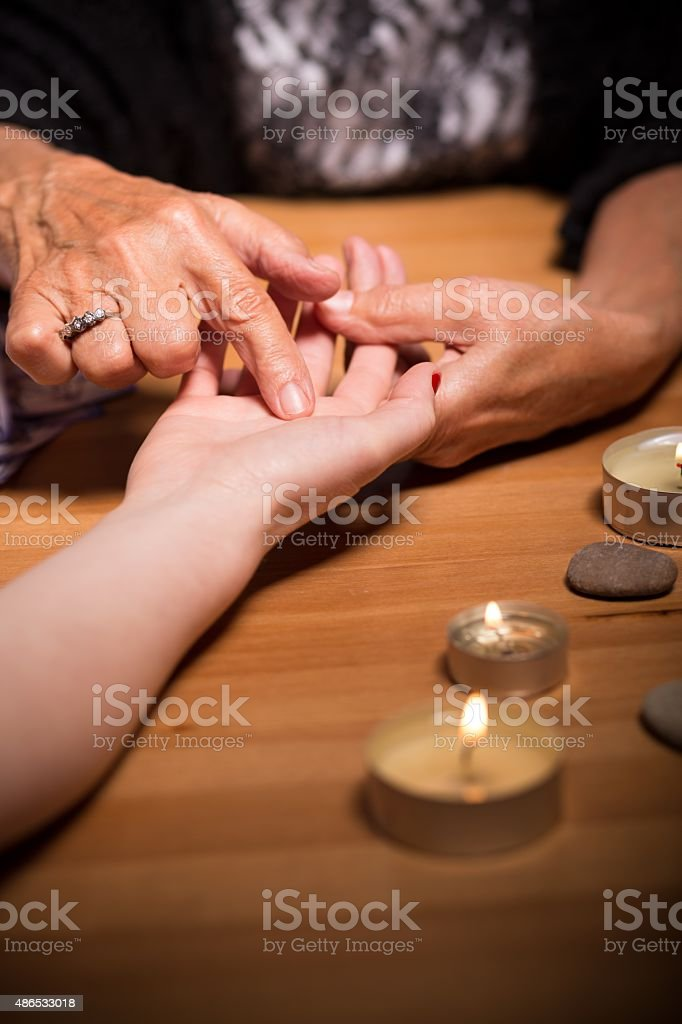 Fortune teller pointing lifeline stock photo