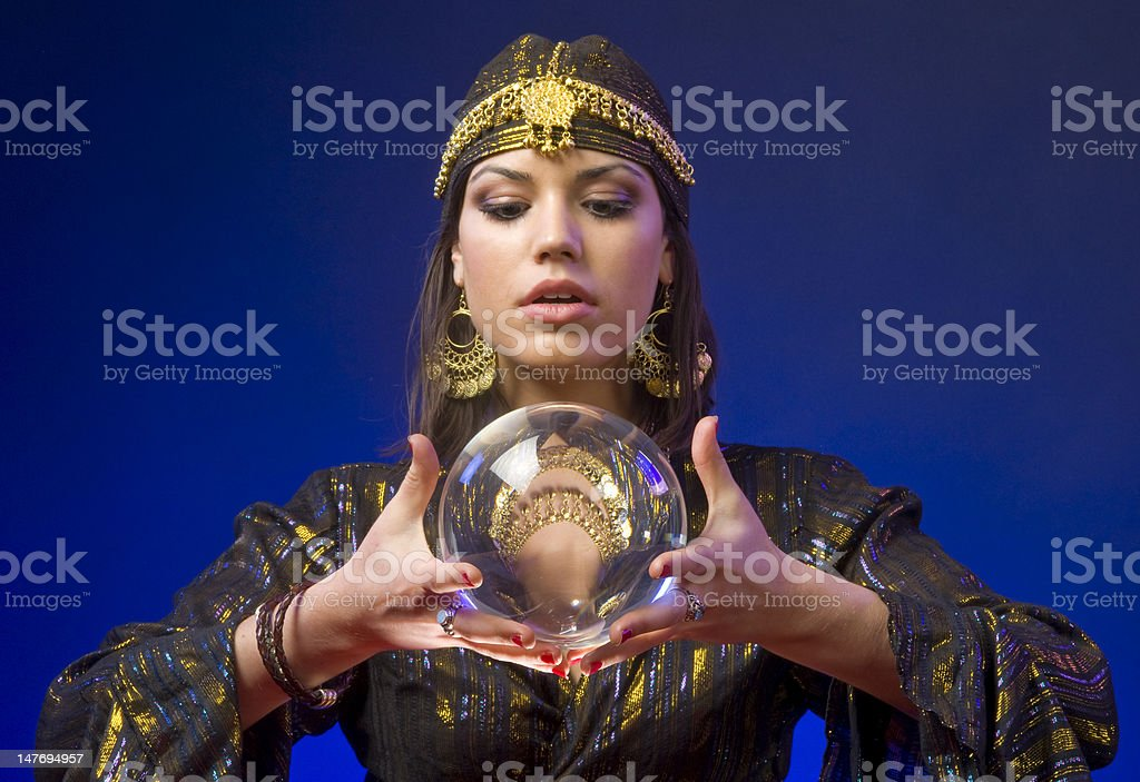 A fortune teller with a crystal ball stock photo