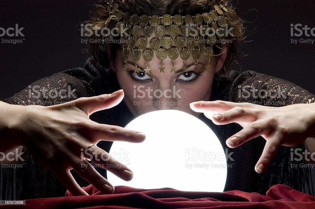 fortune teller with glowing crystal ball stock photo