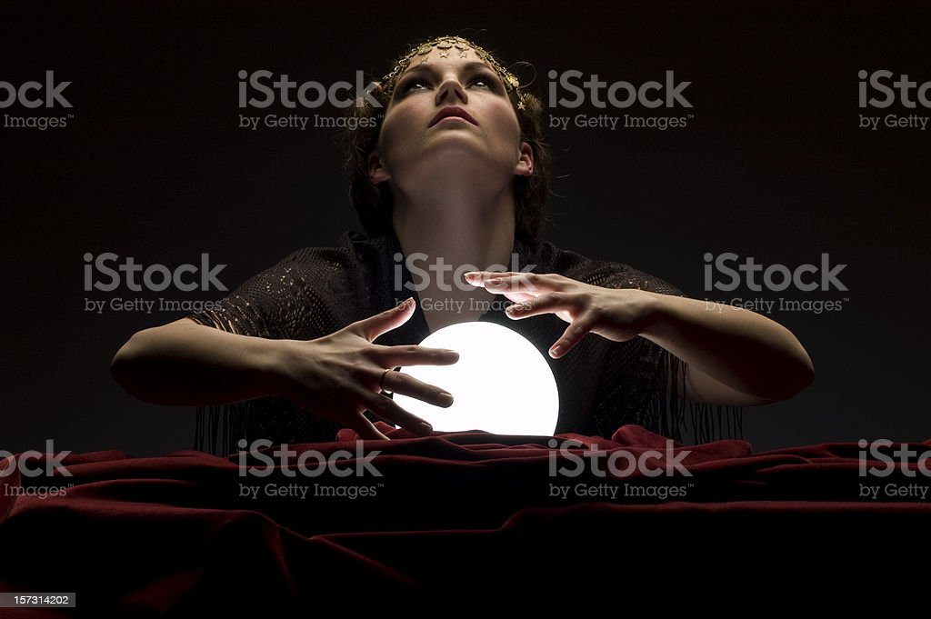 fortune teller with glowing crystal ball royalty-free stock photo