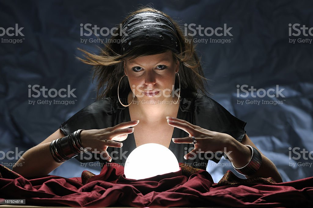 fortune teller with glowing crystal ball XXXL stock photo