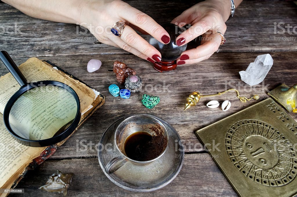 Fortune teller woman predicting future from cards stock photo