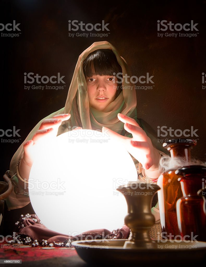 fortune telling with a crystal ball stock photo