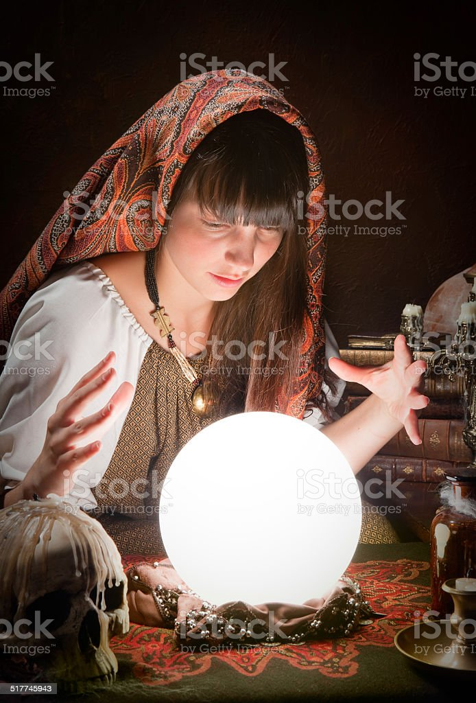 Fortune-teller and a crystal ball stock photo