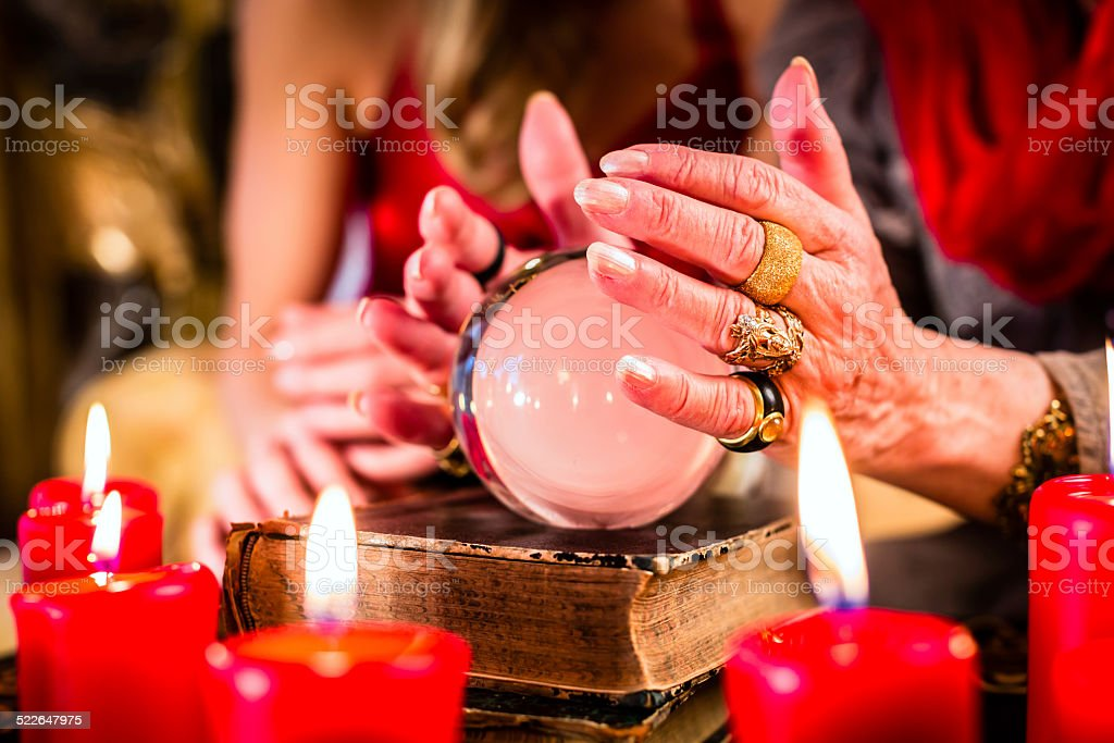 Fortuneteller during Seance with crystal ball stock photo