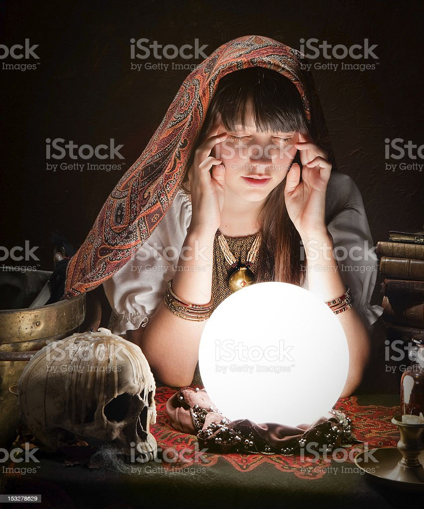 Fortuneteller with crystal ball stock photo