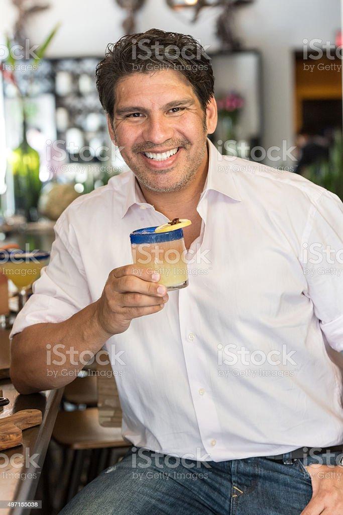 Forty something man having a martini stock photo