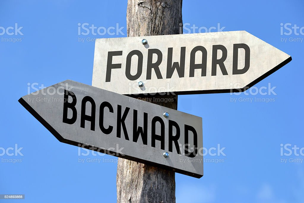 Forward and backward signpost stock photo