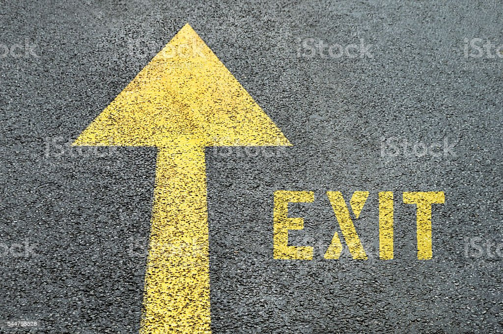Forward road sign with Exit word on the asphalt road. stock photo