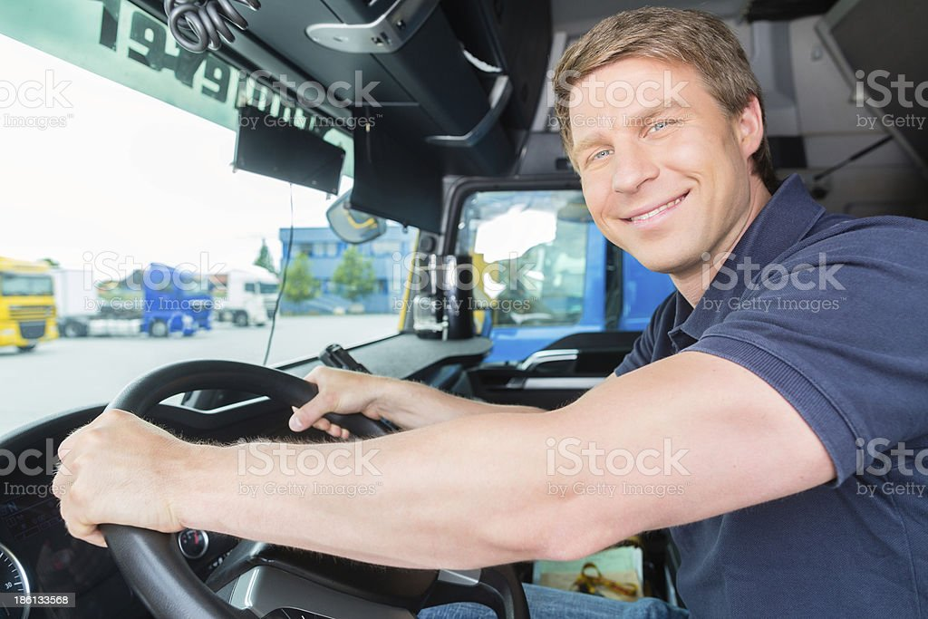 Forwarder or truck driver in drivers cap stock photo