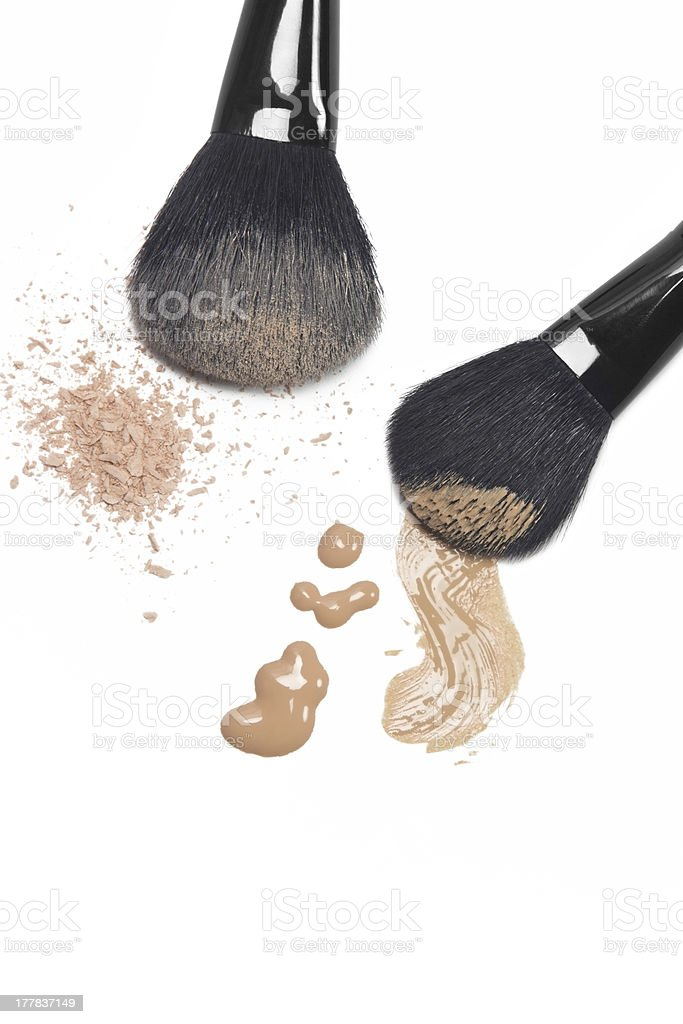 Foundation and powder with brushes royalty-free stock photo