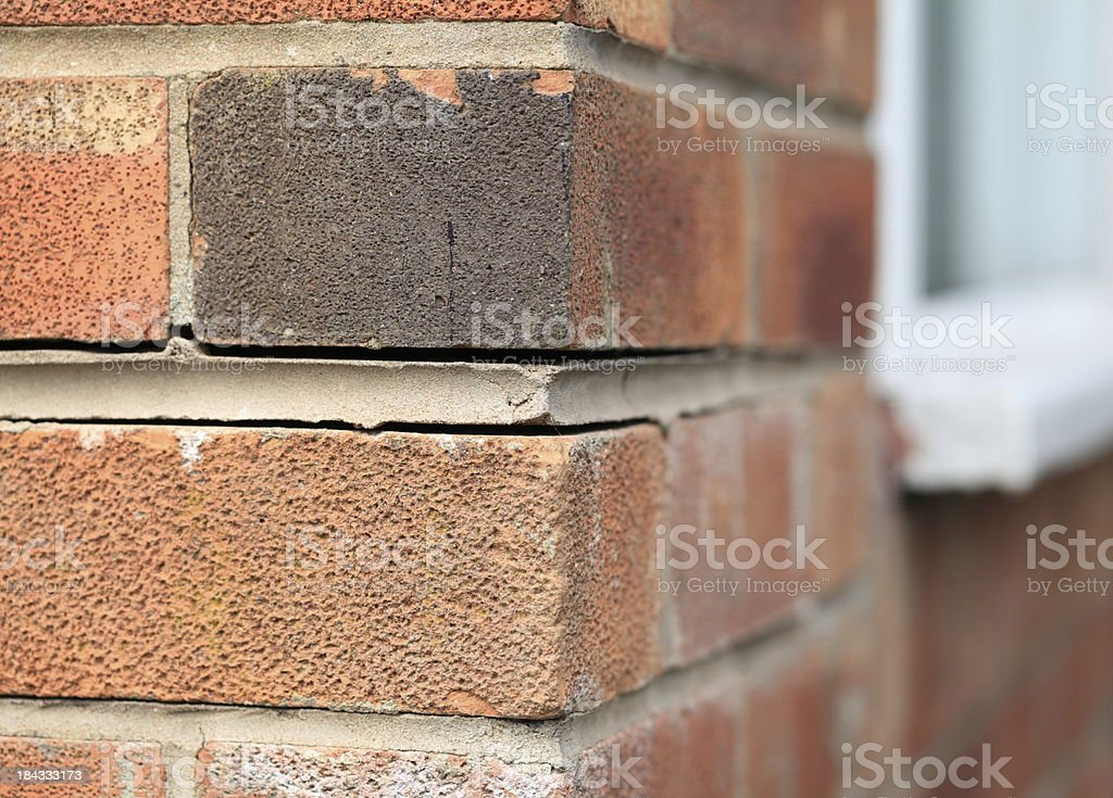 Foundation problems causing house bricks to part. stock photo