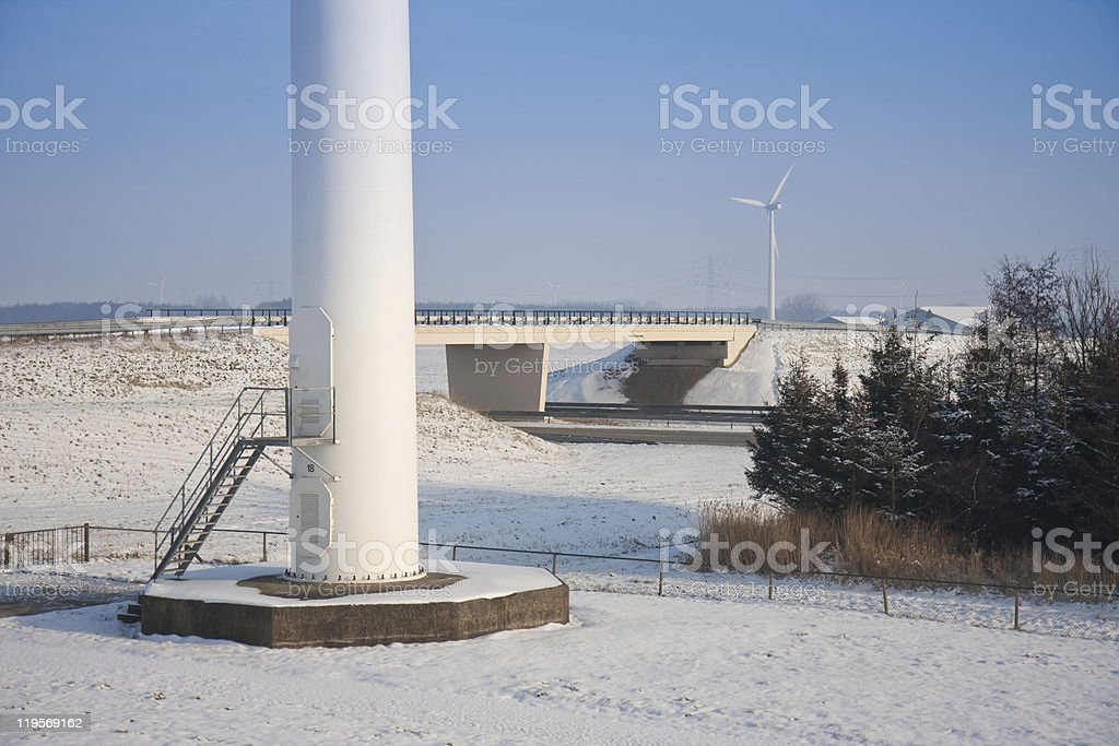 Foundation  windmill near motorway in snowy landscape of he Netherlands royalty-free stock photo