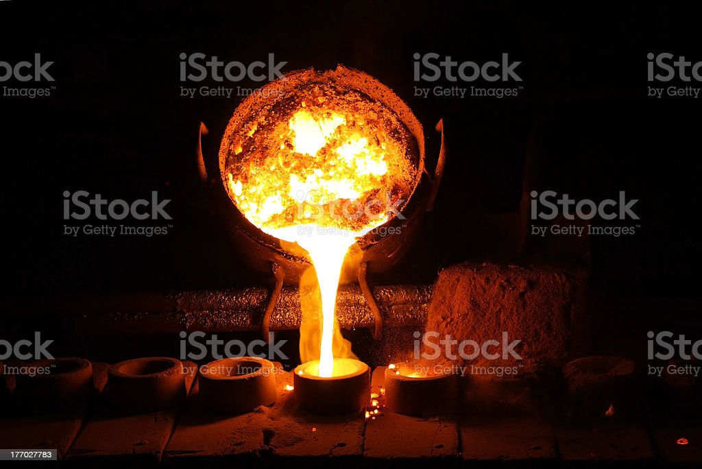 Foundry - molten metal poured from ladle stock photo
