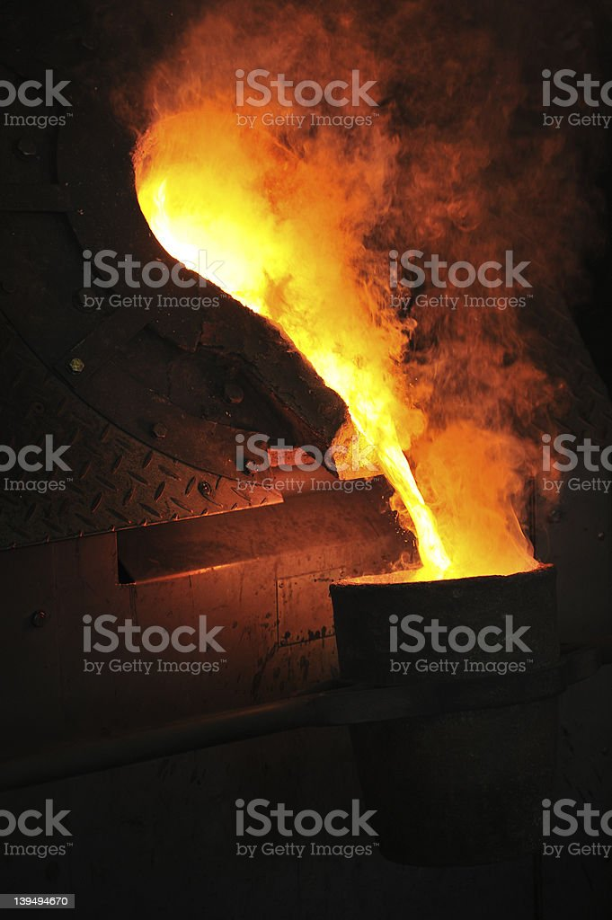 Foundry with molten metal pouring royalty-free stock photo