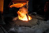 Foundry worker melting metal for casting spare parts