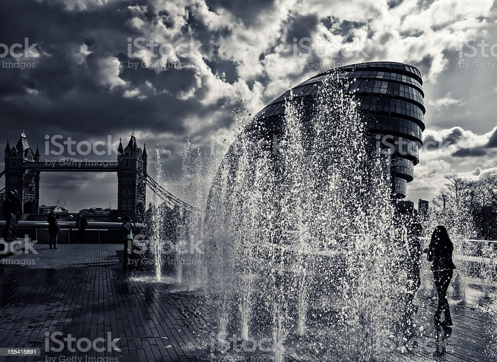 Fountain against City Hall and Tower Bridge, London royalty-free stock photo