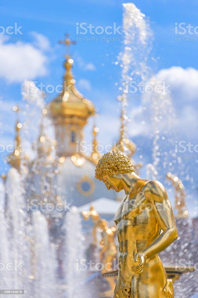 Fountain and church of Peterhof. St Petersburg, Russia stock photo