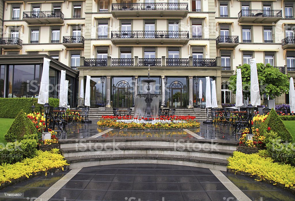 Fountain and flowers in front of beautiful building(Switzerland) royalty-free stock photo