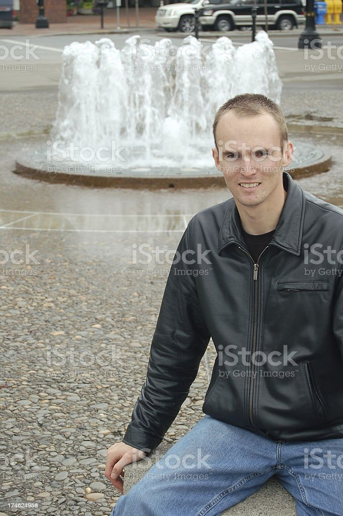 Fountain and Man stock photo