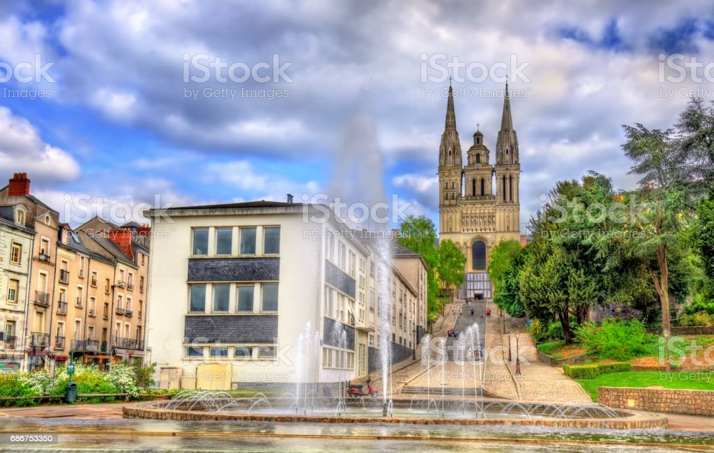 Fountain and Saint Maurice Cathedral of Angers in France stock photo