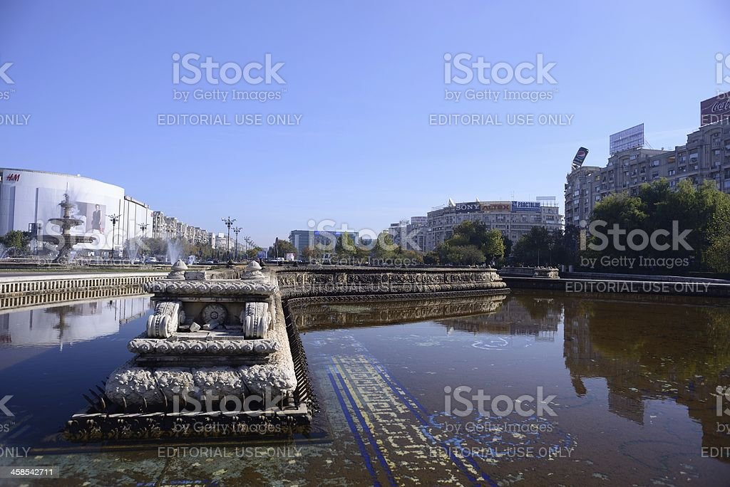 Fountain and Unirea Shopping Center in Bucharest royalty-free stock photo