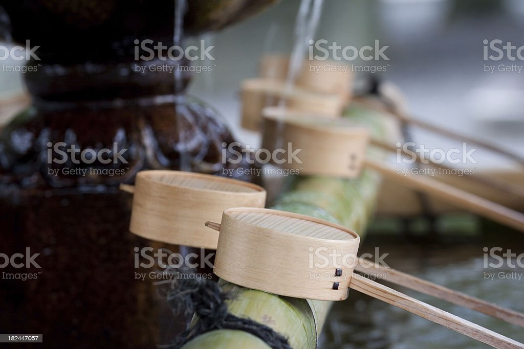Fountain and water cups royalty-free stock photo