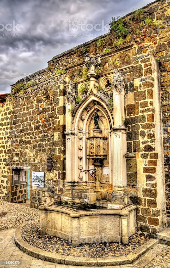 Fountain at the chapel of Saint-Clair d'Aiguilhe - France stock photo