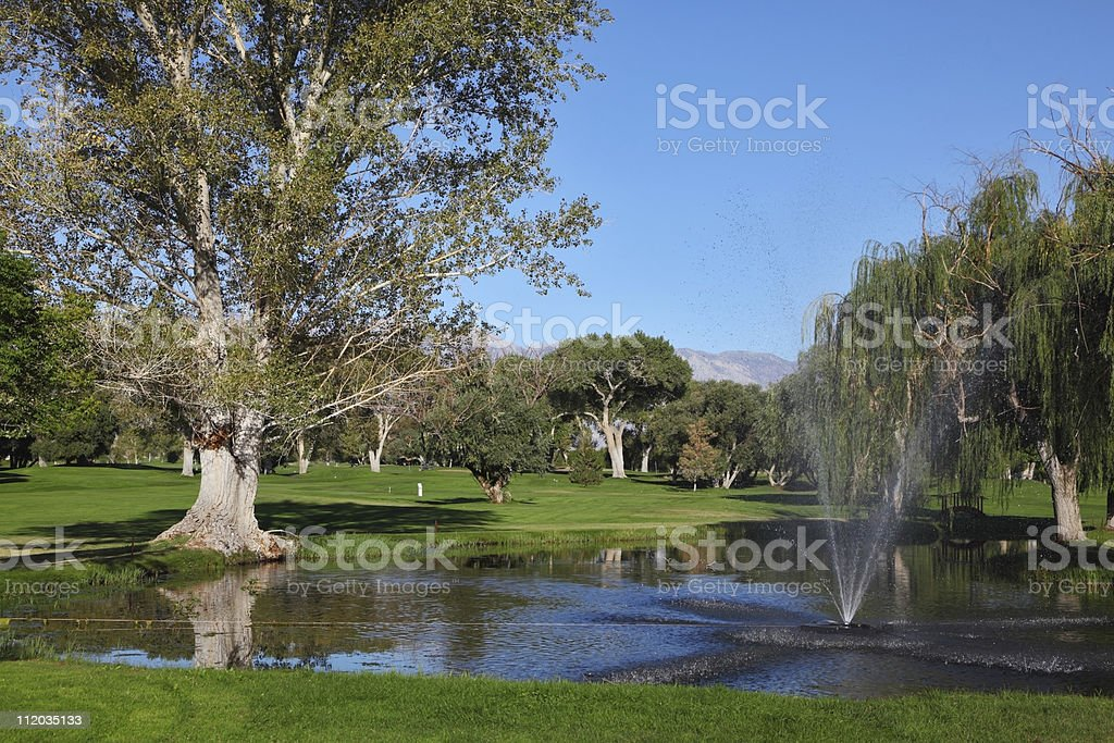 Fountain at the golf course royalty-free stock photo