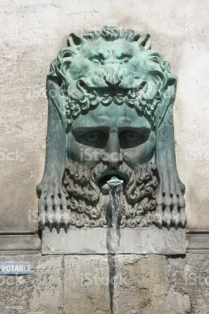 Fountain bronze statue in Arles, France. stock photo