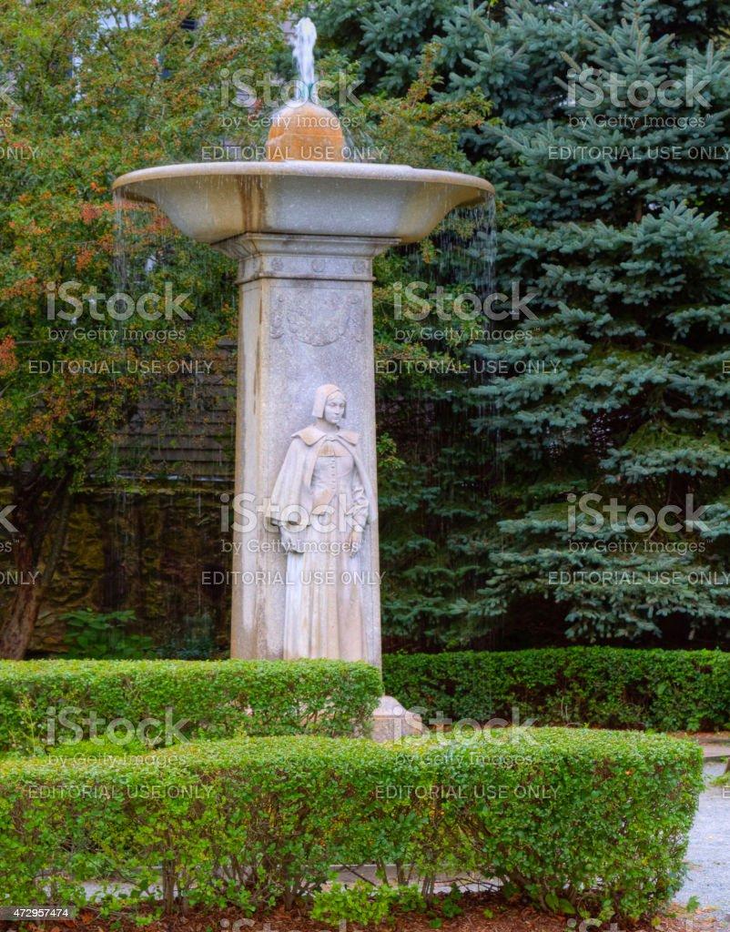 Fountain depicting pilgrim woman, Plymouth, Massachusetts, USA. stock photo