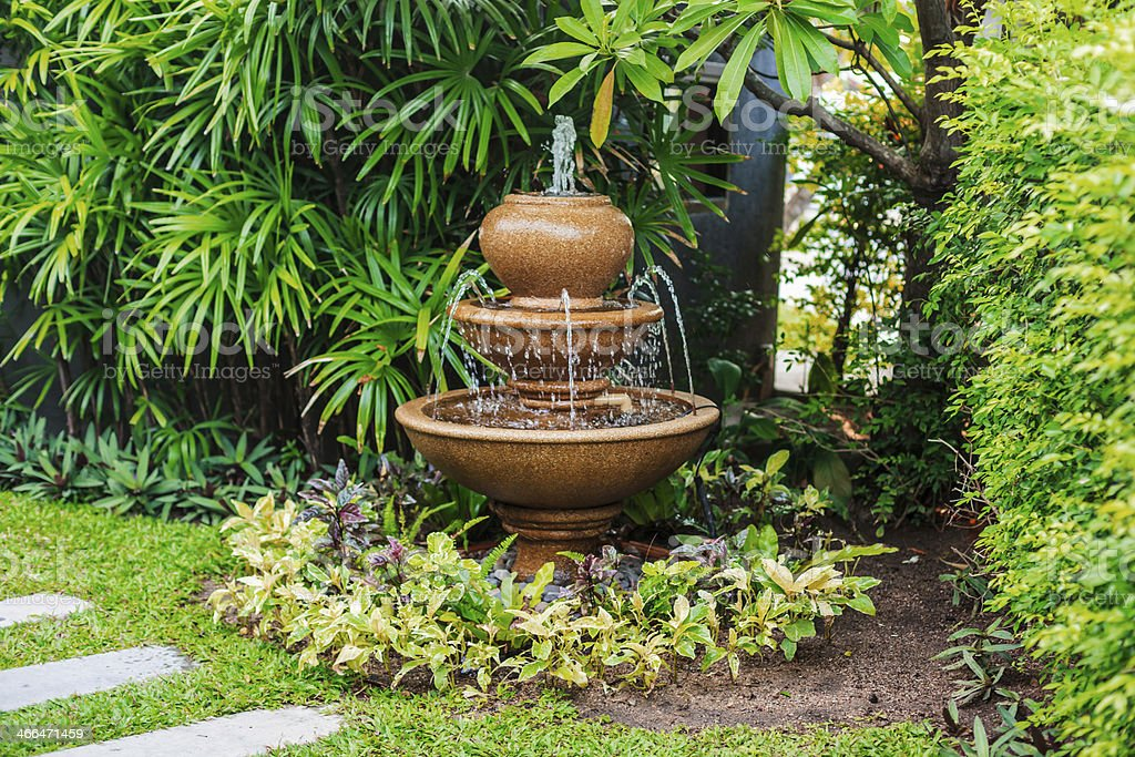Fountain in garden stock photo