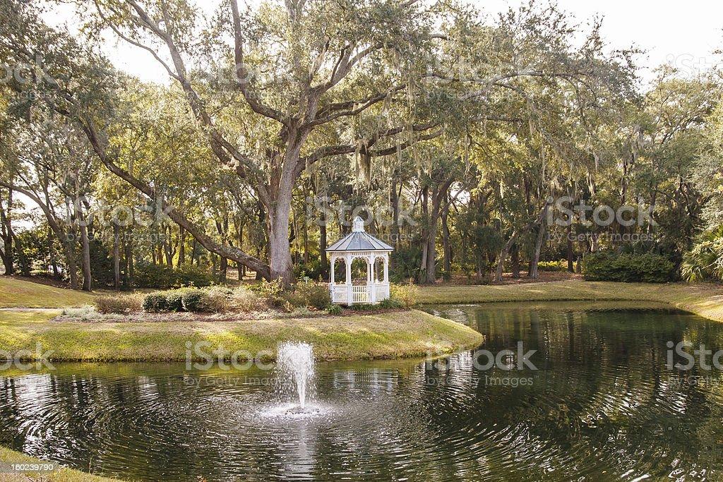 Fountain in Lake by Gazebo royalty-free stock photo