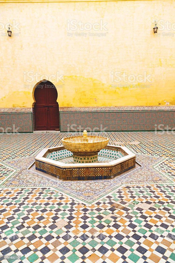 fountain in morocco africa old door stock photo