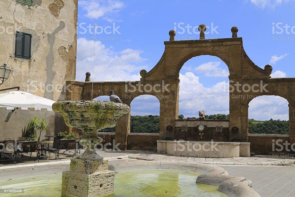 Fountain in Pitigliano square stock photo