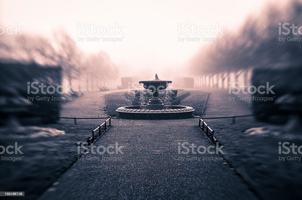 Fountain in Regent's Park during a foggy day stock photo