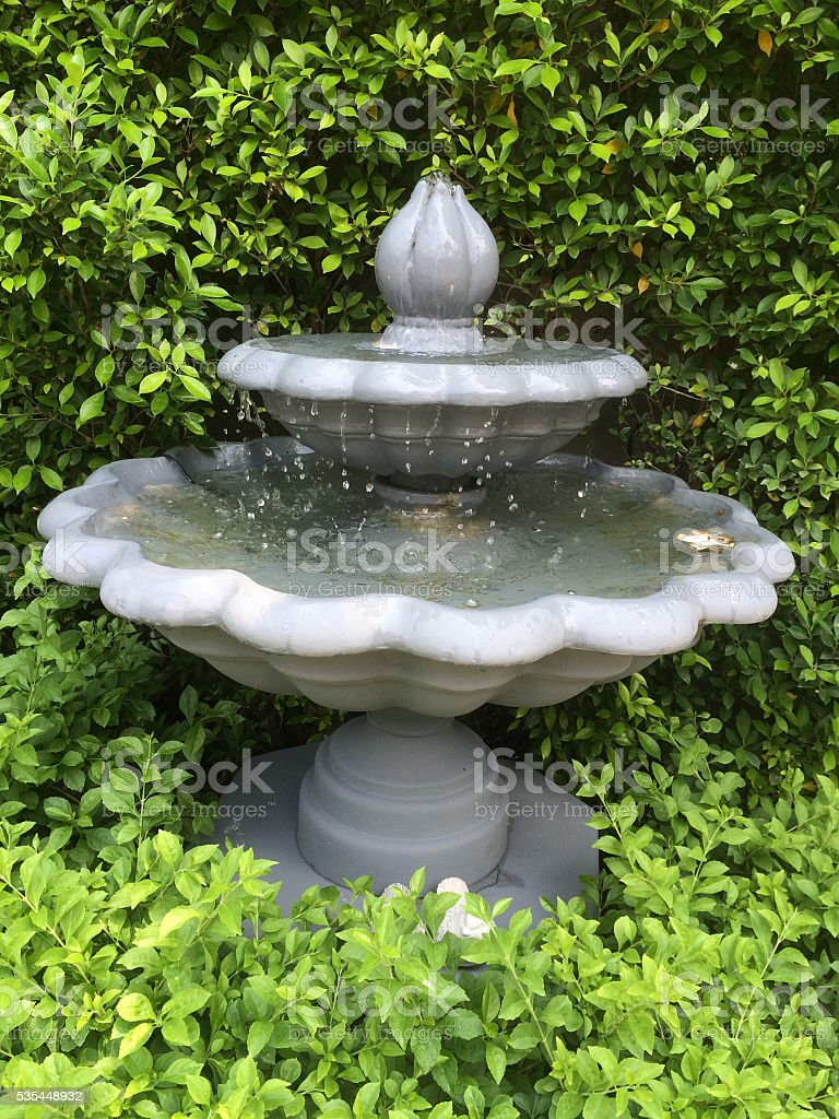 Fountain in the English garden style stock photo