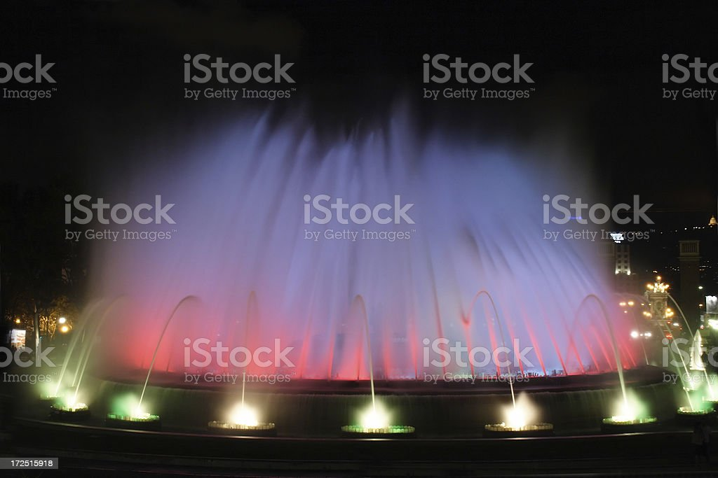 Fountain lit with colored lights stock photo