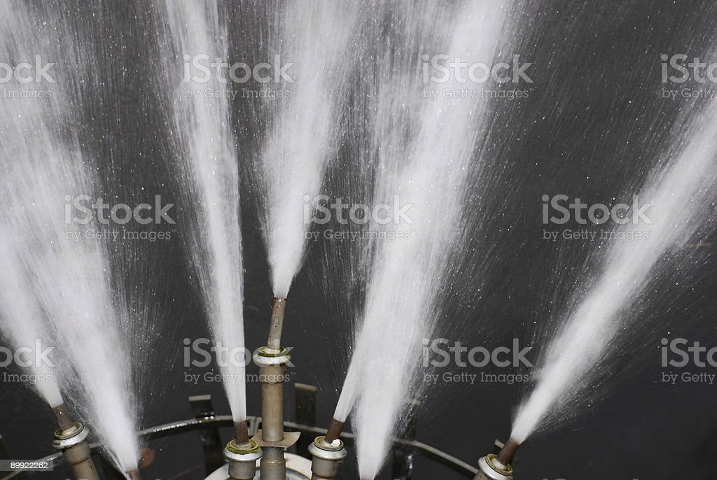Fountain Nozzles in Flash Light royalty-free stock photo