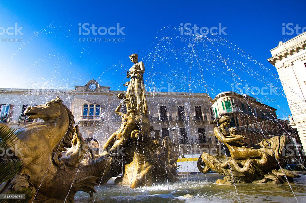 Fountain of Diana in Siracusa, Sicily; Brilliant Blue Sky stock photo