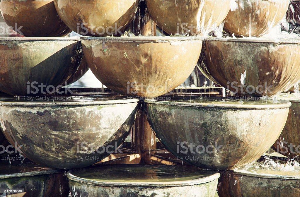 Fountain of round containers stock photo