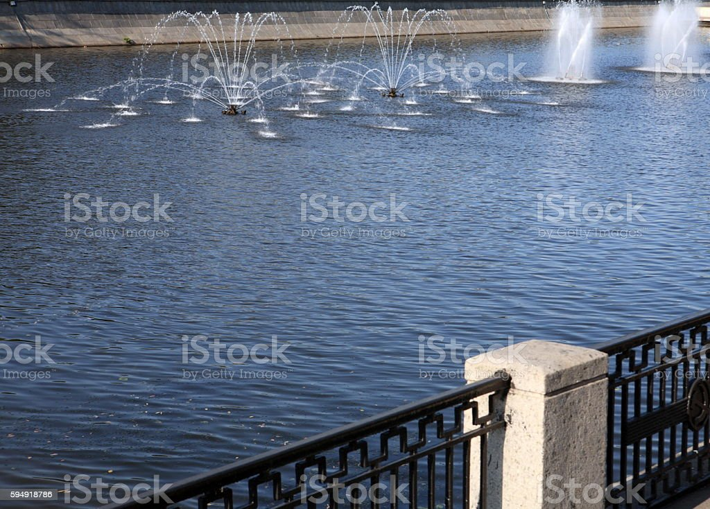 fountain on river at day stock photo