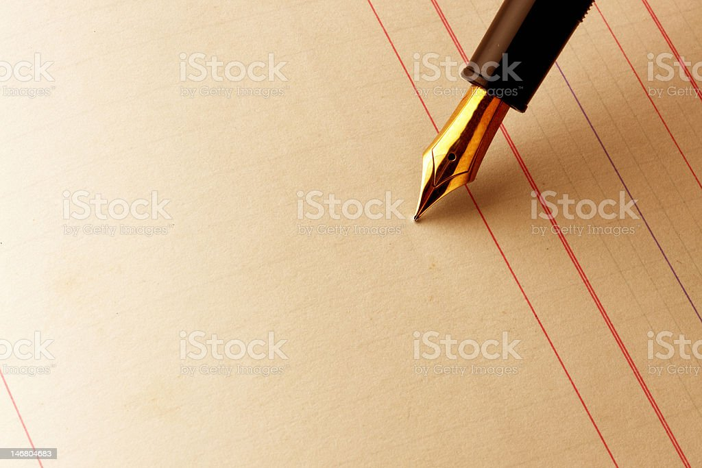 Fountain pen about to write on ledger paper stock photo