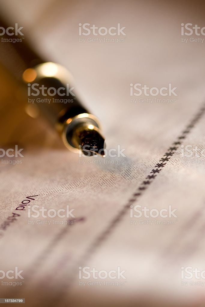Fountain pen and cheque royalty-free stock photo