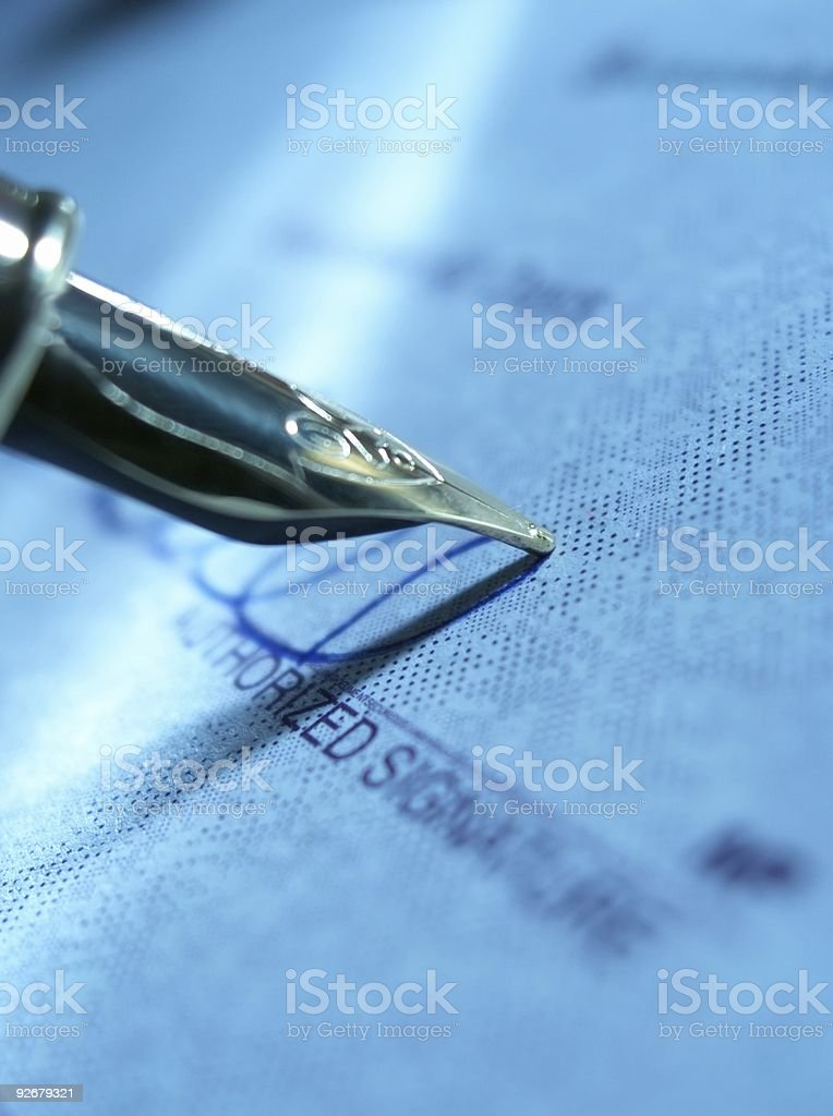 Fountain pen and cheque stock photo