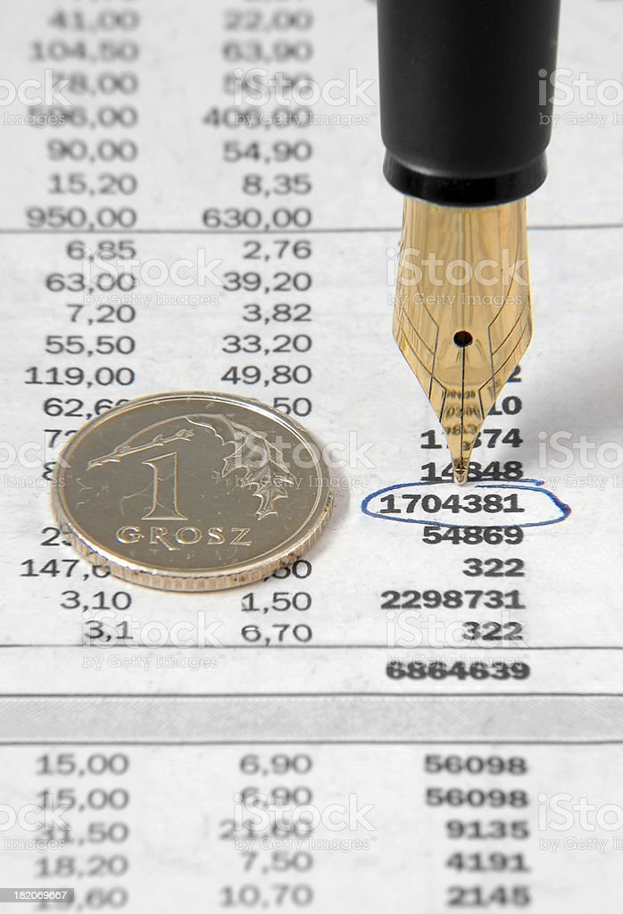 fountain pen and coin royalty-free stock photo