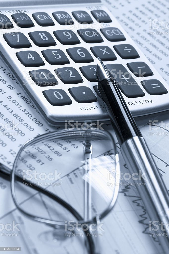 Fountain pen and glasses on stock chart royalty-free stock photo