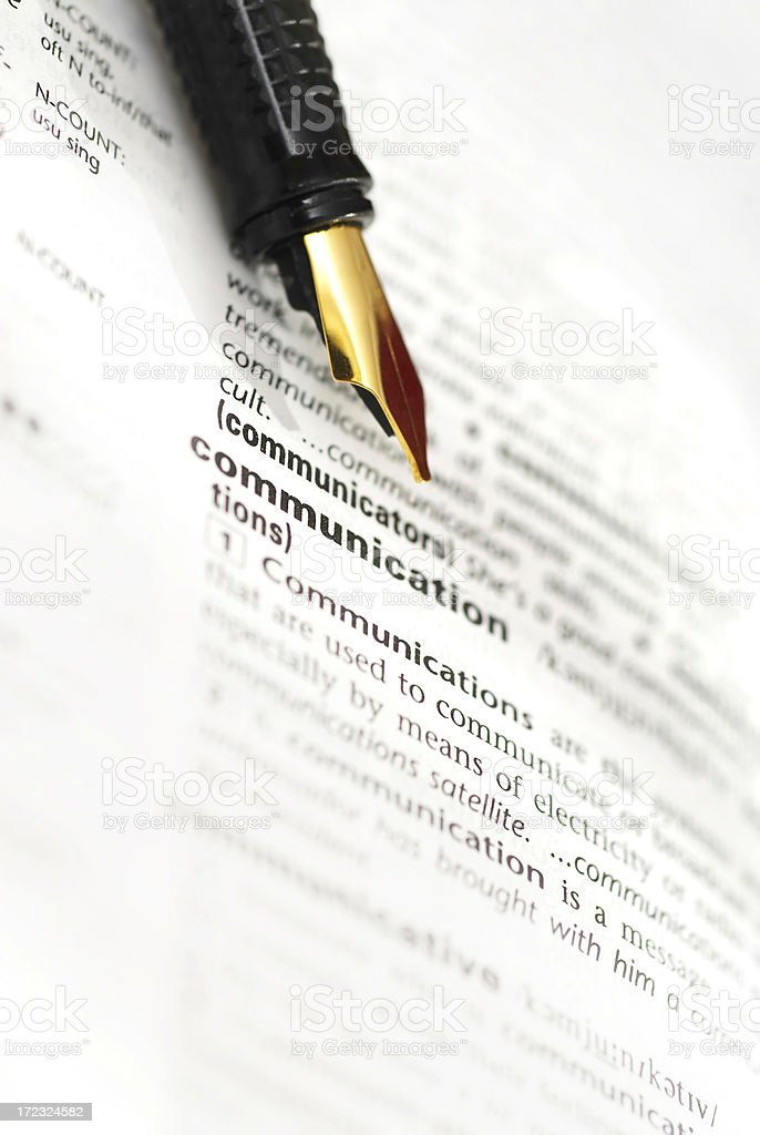 Fountain pen and page of a dictionary royalty-free stock photo