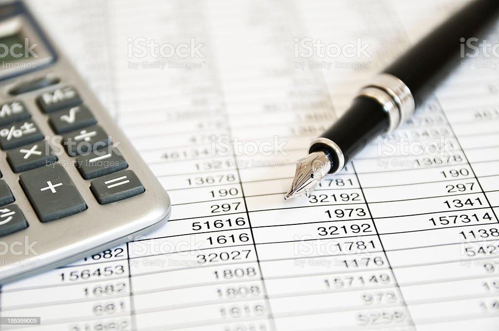 fountain pen, calculator and figures stock photo