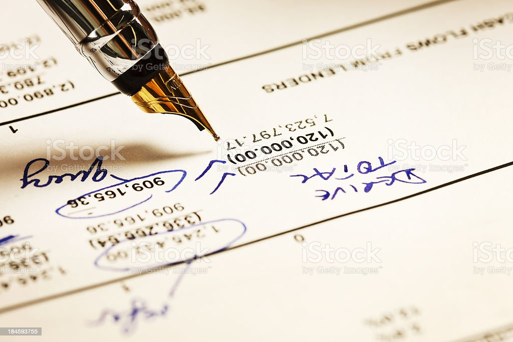 Fountain pen checking and commenting on financial statement stock photo